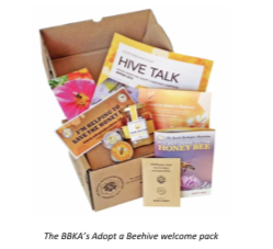 Adopt welcome pack displayed with jar of honey and seed packets